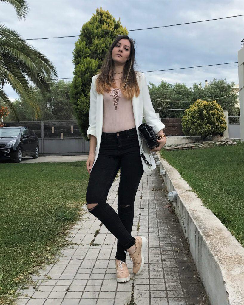 white blazer with black pants